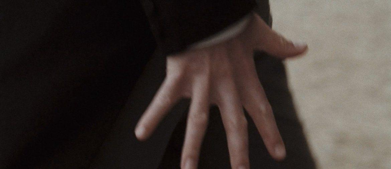 A close up of a hand flexing in Pride & Prejudice
