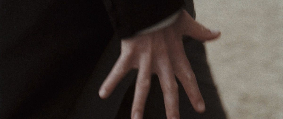 A close up of a hand flexing in Pride & Prejudice